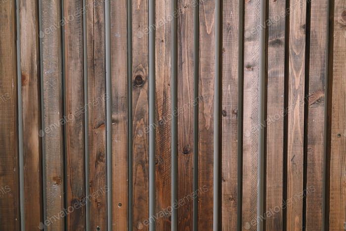 Brown wooden planks interior. Natural wall decoration background.