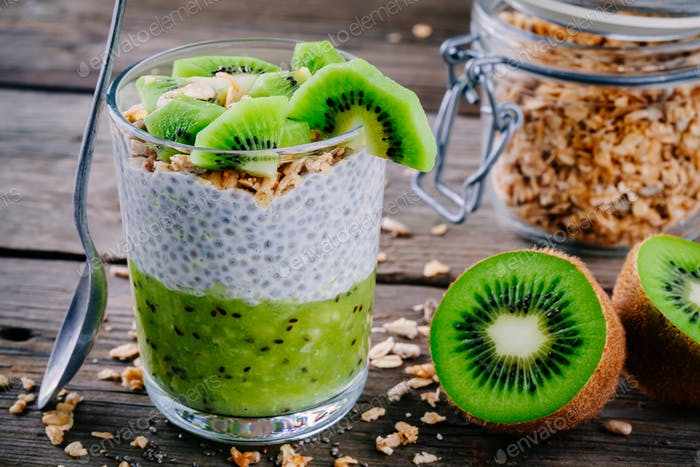 Healthy breakfast. chia pudding with kiwi and granola in glass