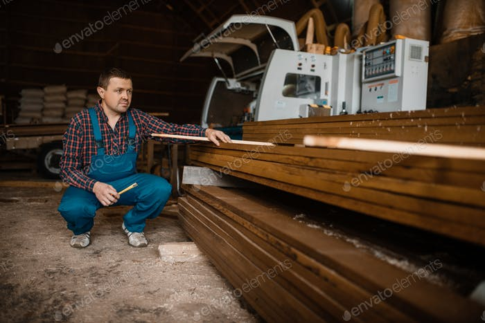 Thumbnail for Carpenter in uniform at his workplace on sawmill