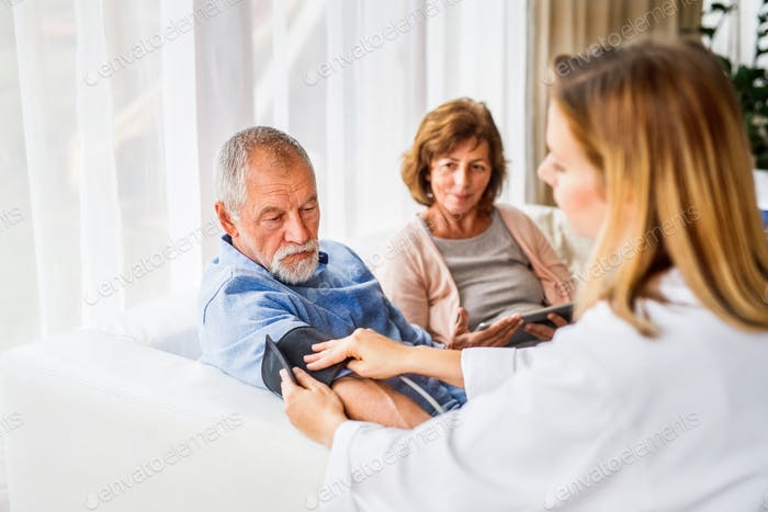 Female doctor checking blood pressure of senior man.