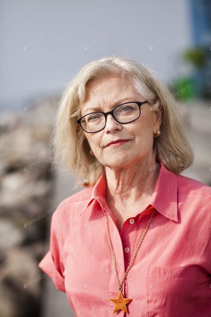 Portrait of confident senior woman outdoors