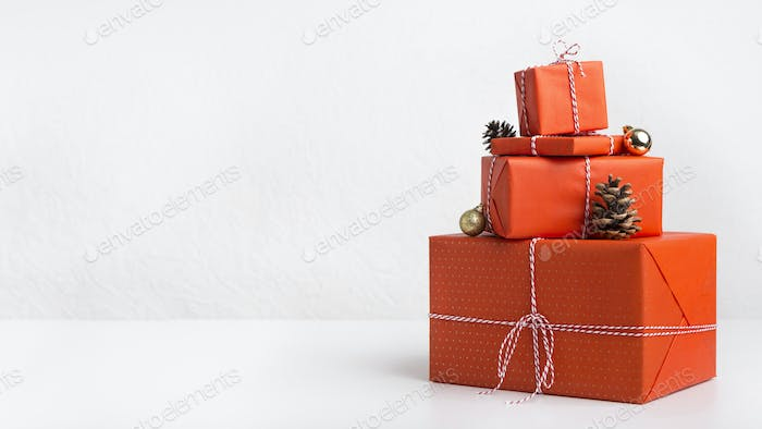 Creative Christmas presents wrapping in red paper on white
