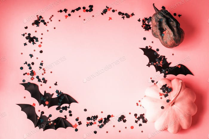Halloween pumpkin and bat with confetti on pink