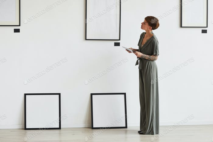 Creative Young Woman Planning Art Gallery