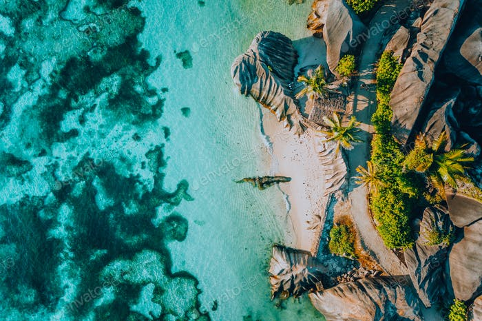 Aerial photo of famous paradiselike tropical beach Anse Source D Argent at La Digue island