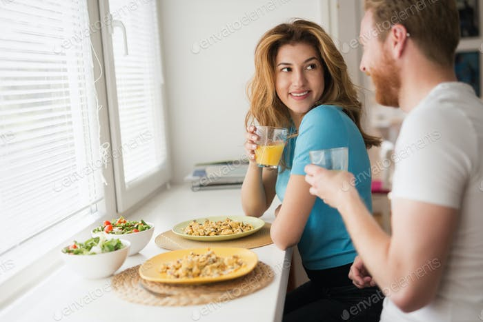 Couple in love having breakfast at home