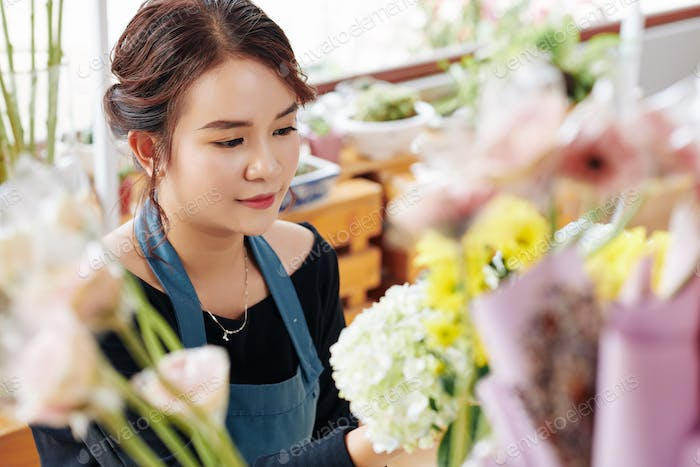 Lovely florist working at flower studio