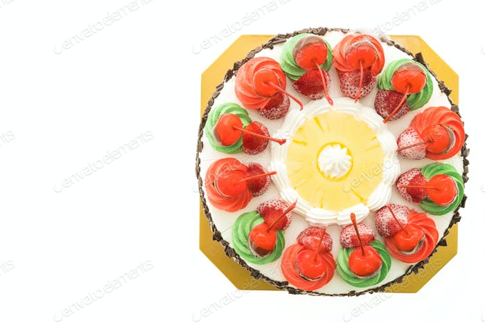 Ice cream cake with christmas theme and cheery on top