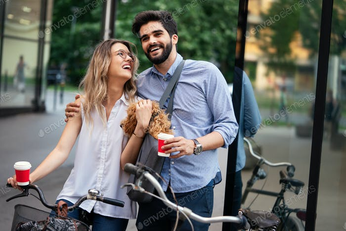 Bicycle, love, couple, relationship and dating concept. Couple with bicycles in the city