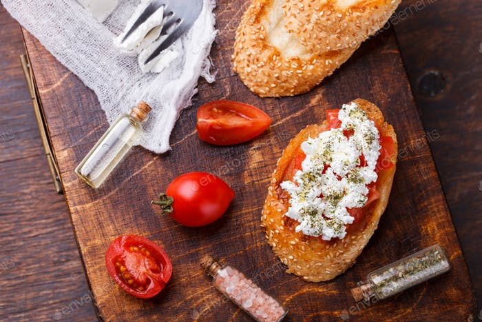 Bruschetta with tomato and feta cheese.
