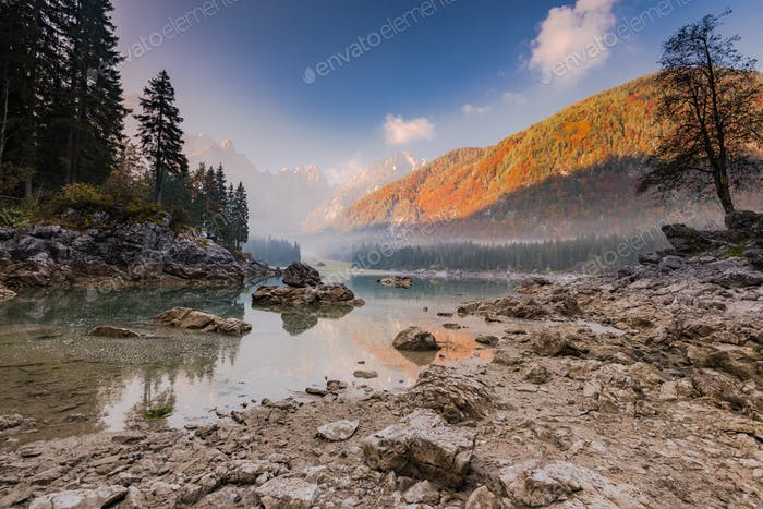 Scenic nature with autumn colors over alpine lake