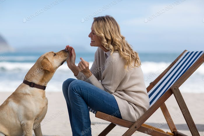 Mature woman petting her dog