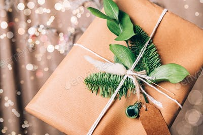 Hands are holding gift in eco paper