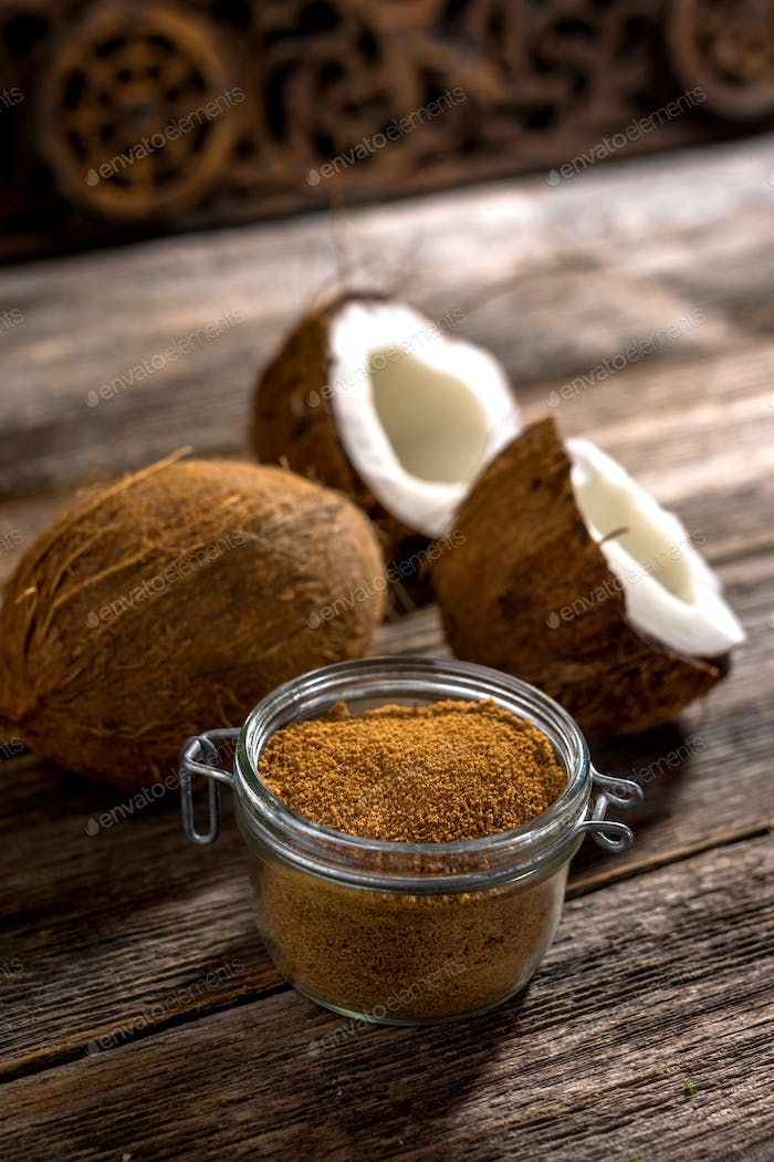 Coconut palm sugar on rustic wooden background