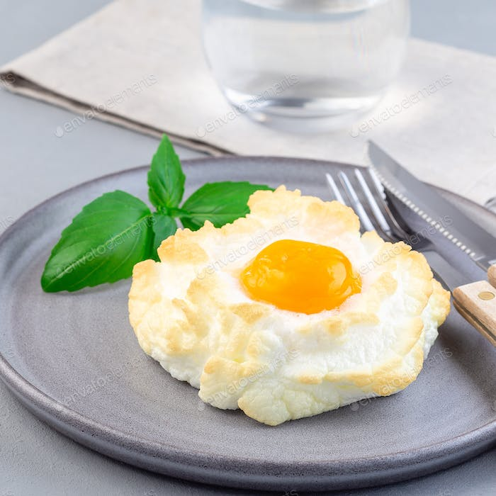 Trendy cloud or fluffy egg dish on  gray plate, square format