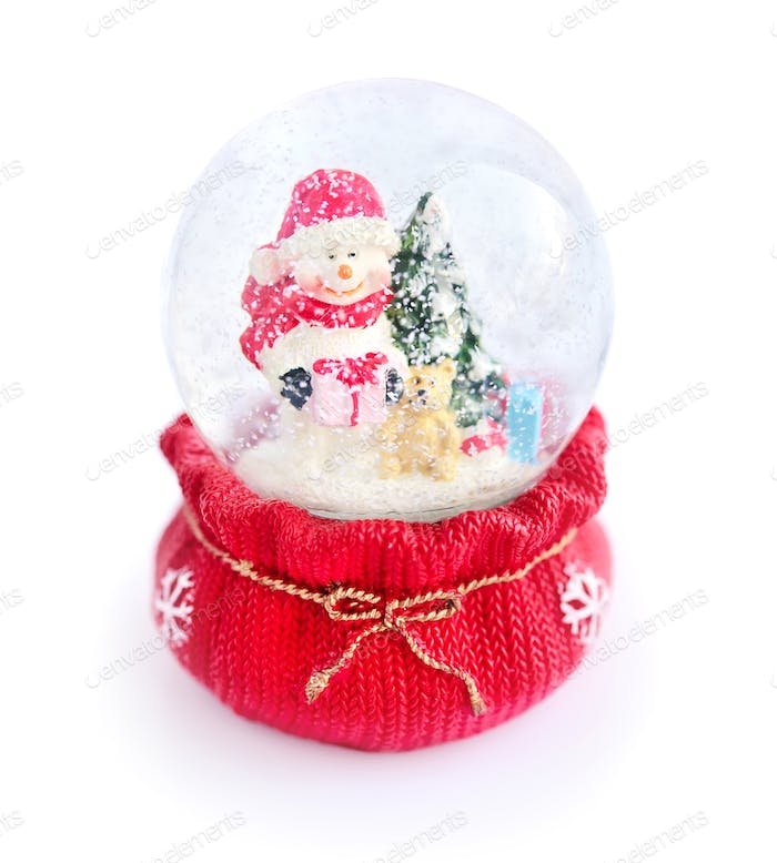 A snow globe with snowman on white background