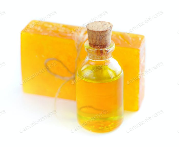 Essential oil with a floral handmade soap on white background. S