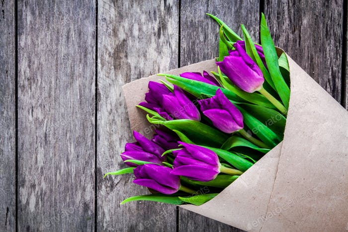 bouquet of purple tulips on a rustic background closeup