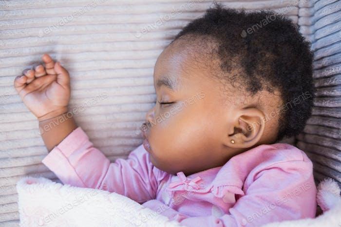 Little girl sleeping on the sofa on living room