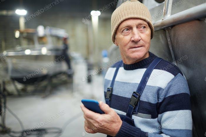 Engineer with smartphone