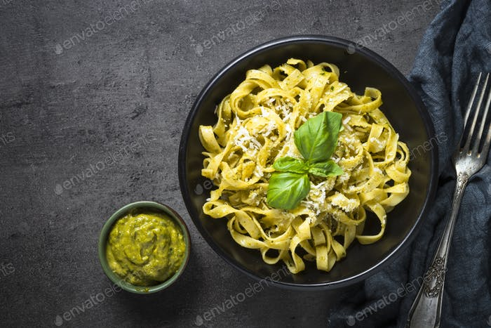 Tagliatelle pasta with pesto sauce and parmesan