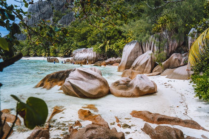La Digue, Seychelles. Hiking tour around tropical exotic paradise island with granite boulders and