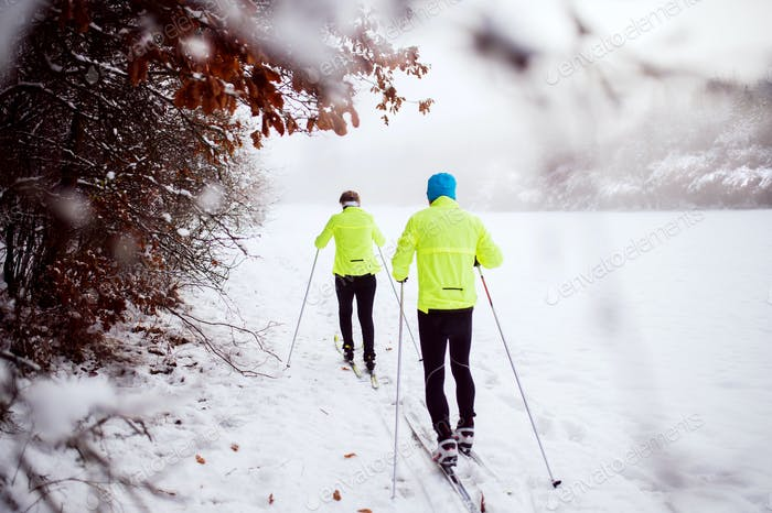 Senior couple cross-country skiing.