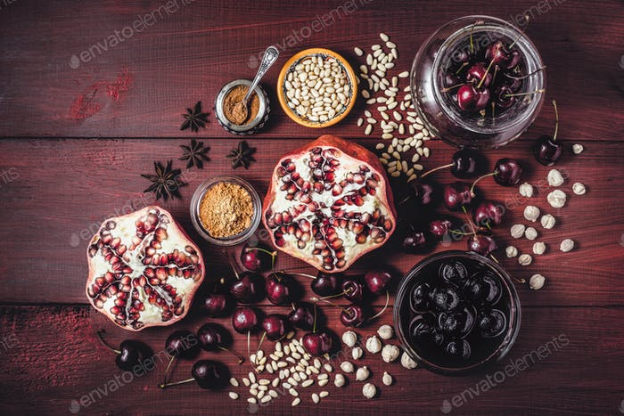 Still life with pomegranate, cherry and spices.