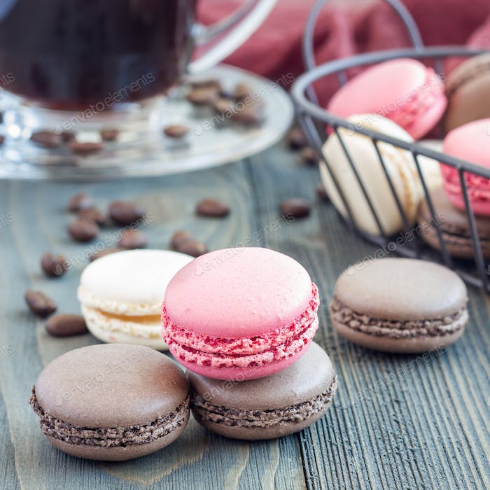 Different kinds of colorful french dessert macaron, served with coffee, square