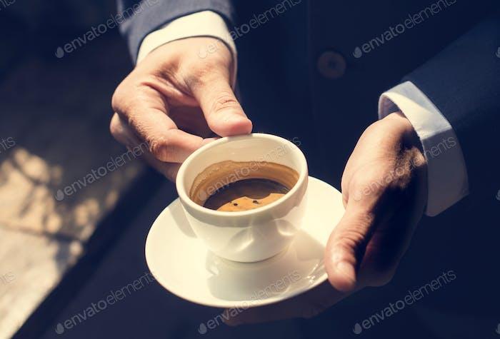 A businessman  having coffee