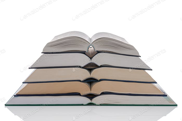 Open hardback books stack isolated on white
