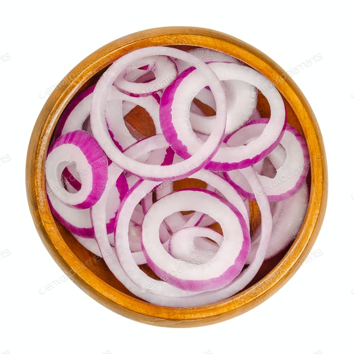 Red onion rings in a wooden bowl
