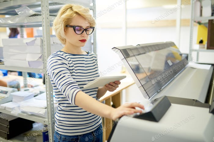 Modern Woman Using Plotter