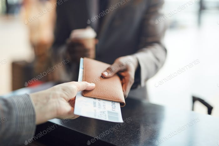 Unrecognizable Man At Check-In Counter