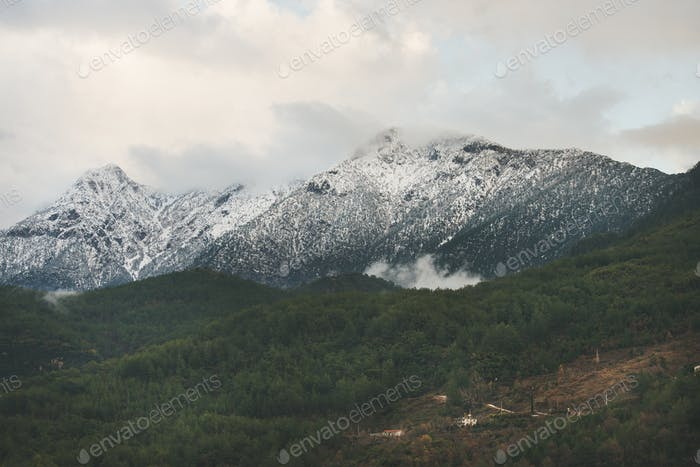 Green slopes of the Taurus mountains with snow, Alanya, Turkey
