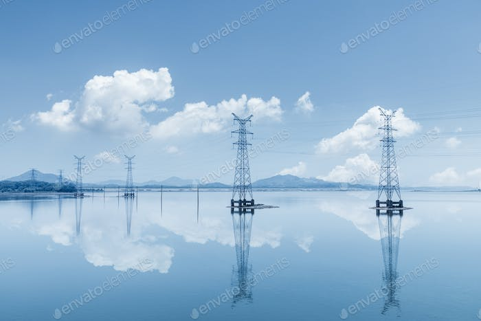 electricity transmission pylon on lake