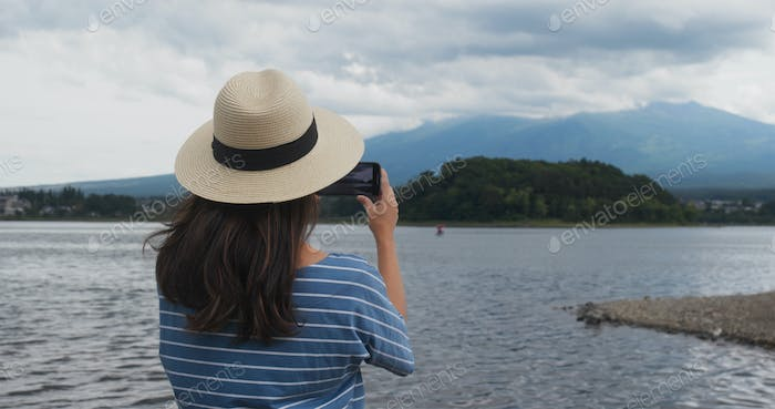 Woman take photo on Mountain Fuji