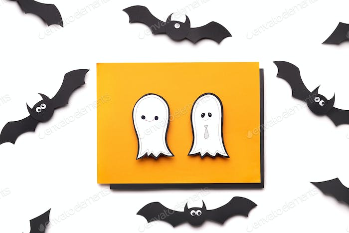 Halloween paper background with ghosts and flying bats