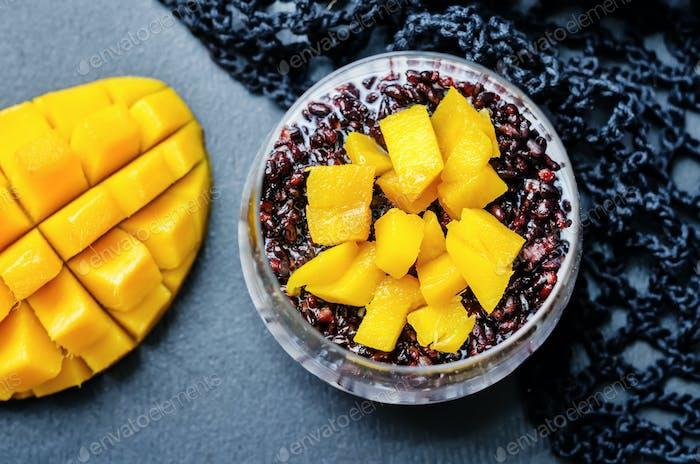 Coconut black rice mango pudding