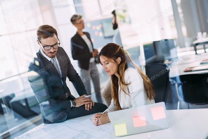 Portrait of young architects discussing in office