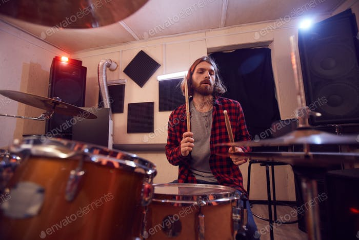 Contemporary Bearded Man Playing Drums