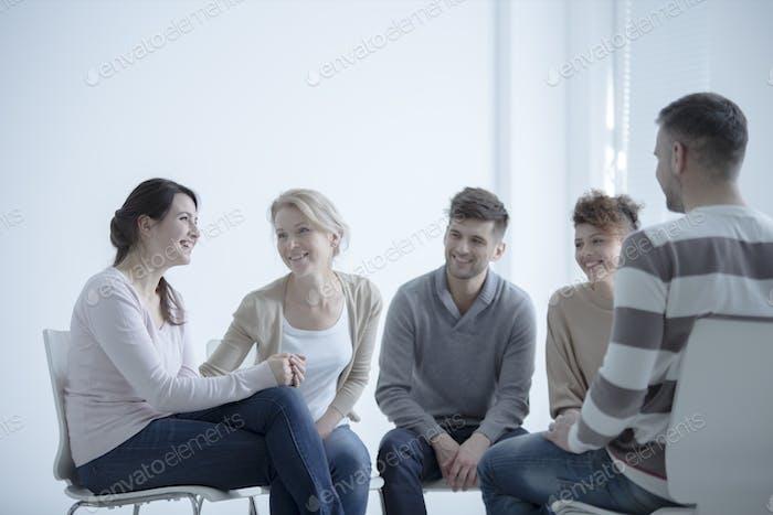 Smiling girl during meeting