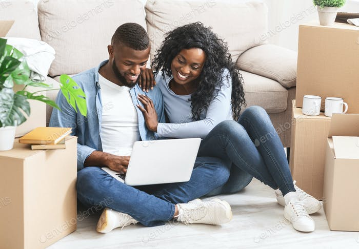 Just married couple making shopping online at new house