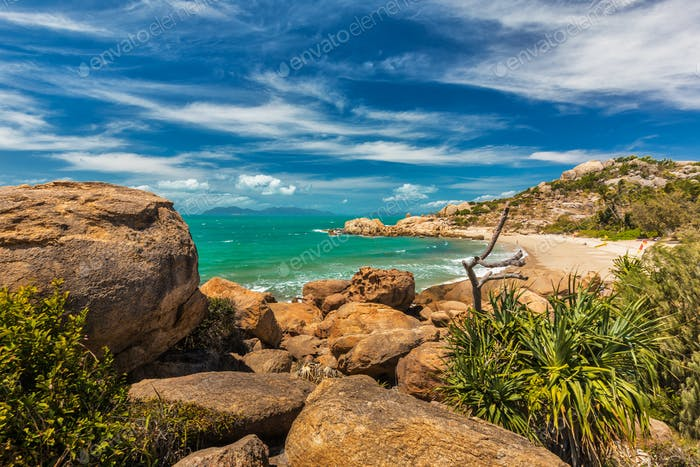 Horseshoe Bay at Bowen - iconic beach with granite climbing rock