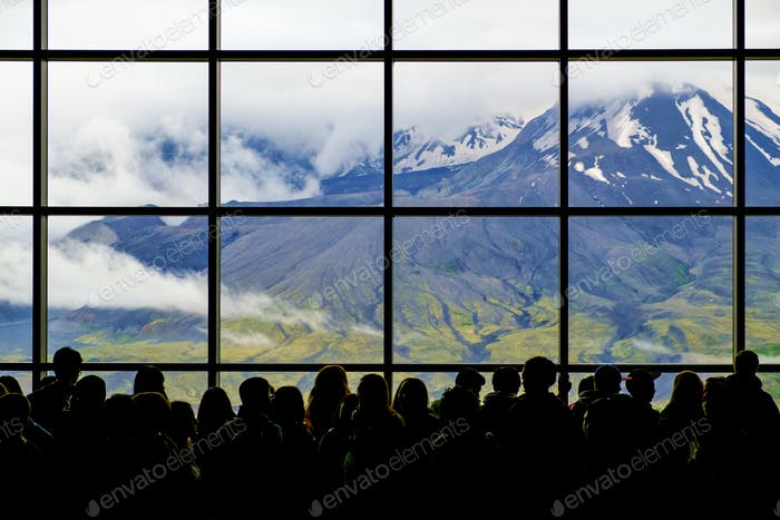 Crowd at window with scenic view of mountain