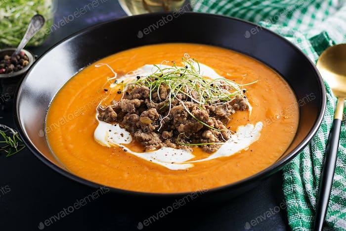 Delicious cream of pumpkin soup with roasted forcemeat