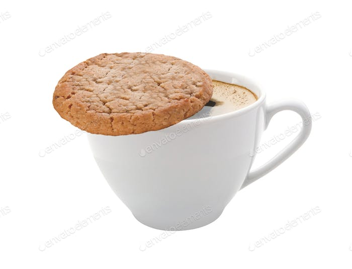 Cup of coffee and a cookie isolated