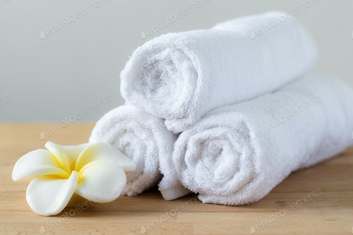 Frangipani flower with towel won wooden table