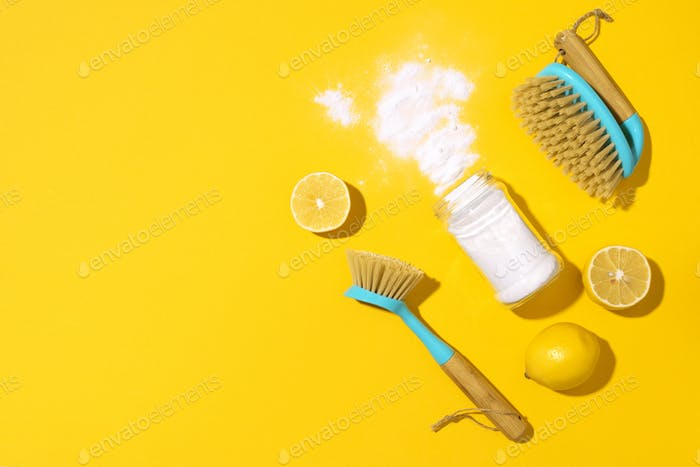 Baking soda, lemon, mustard powder and bamboo brushes against household chemicals products over