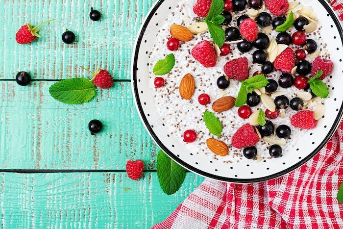 Vegan almond milk chia seeds pudding with raspberries, blackberries and  mint.